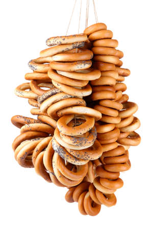 baranka: tasty bagels on rope, isolated on white