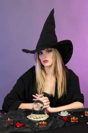 Witch with crystal ball. Fortune telling. On color background Stock Photo - 15964062