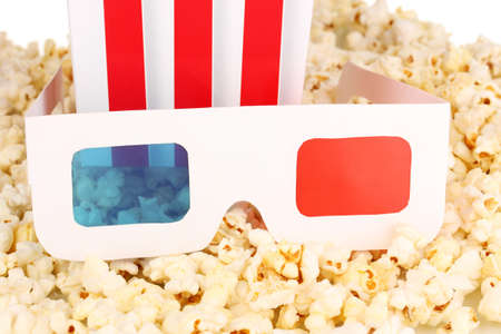 cinema glasses on popcorn background photo