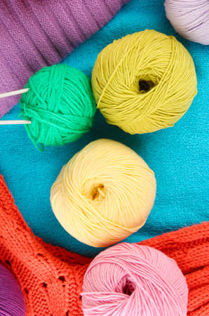 colorful wool sweaters and balls of wool close-up Stock Photo - 15964962