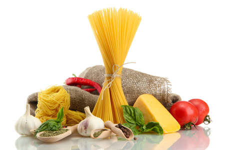 Pasta spaghetti, vegetables and spices, isolated on white Stock Photo - 16036516