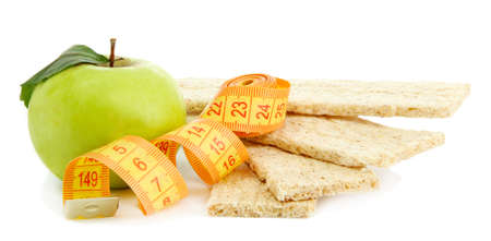 tasty crispbread, apple and measuring tape, isolated on white Stock Photo - 16035775