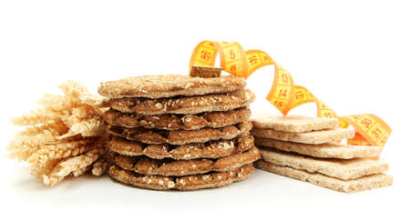 tasty crispbread, measuring tape and ears, isolated on white photo