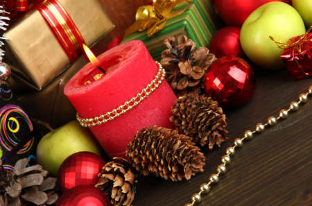 Composition from Christmas decorations close-up on wooden table on wooden background Stock Photo - 16037913