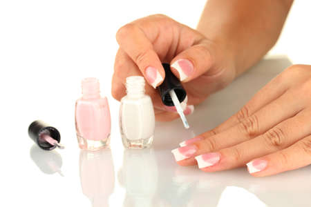 Woman makes herself a French manicure, on white background Stock Photo - 16036342
