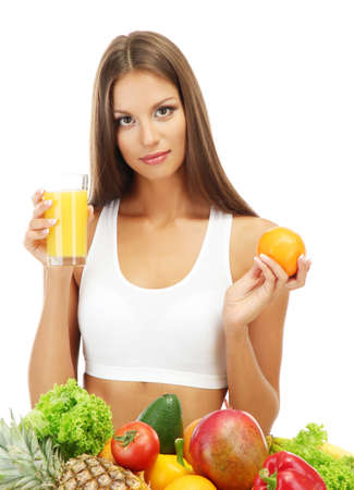beautiful young woman with fruits and vegetables and glass of juice, isolated on white Stock Photo - 16346489