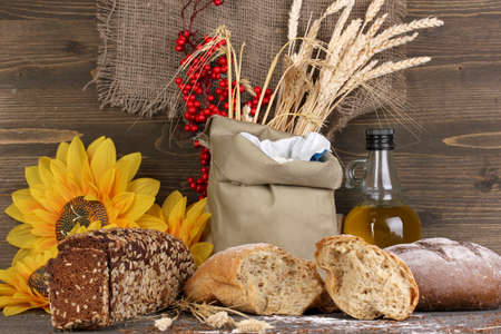 Different types of rye bread on wooden table on wooden background photo