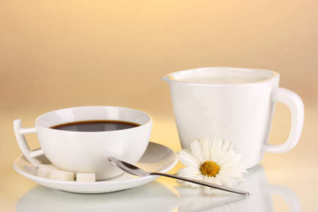 A cup of strong coffee and sweet cream on yellow background Stock Photo - 16036822
