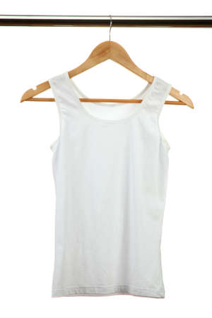 white t-shirt on wooden hanger, isolated on white  photo