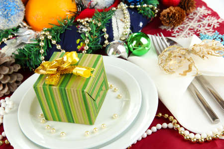 Small Christmas gift on plate on serving Christmas table background close-up Stock Photo - 16087159
