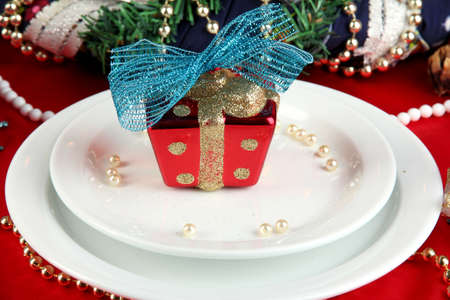 Small Christmas gift on plate on serving Christmas table background close-up Stock Photo - 16087163