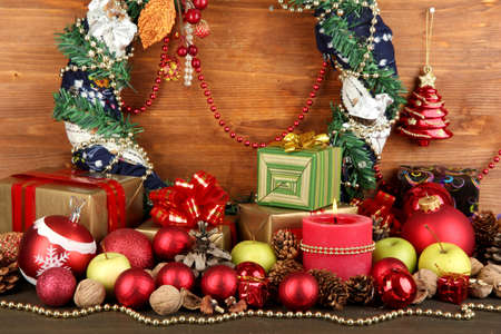 Composition from Christmas decorations on wooden table on wooden background photo
