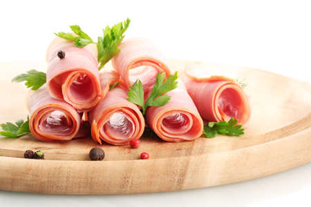 raw ham: tasty bacon with spices on wooden cutting board, isolated on white Stock Photo