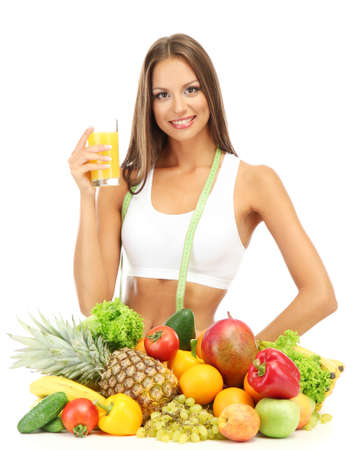 beautiful young woman with fruits and vegetables and glass of juice, isolated on white Stock Photo - 16346293