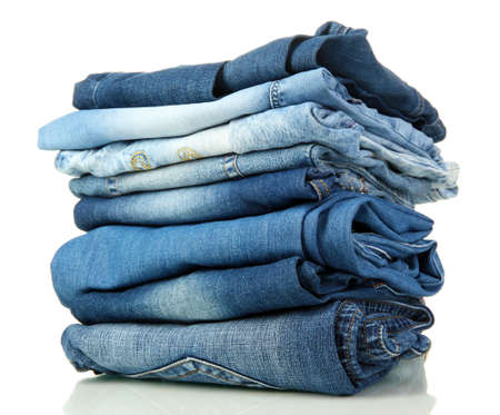 worn jeans: Lot of different blue jeans isolated on white