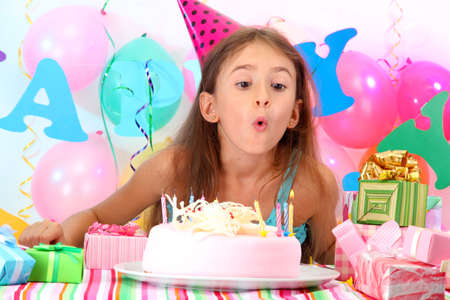 Little beautiful girl celebrate her birthday photo