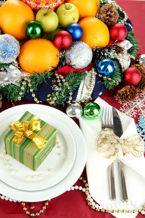 Small Christmas gift on plate on serving Christmas table background close-up Stock Photo - 16108016