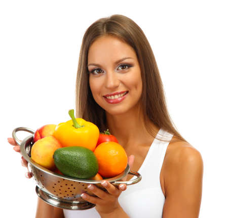 beautiful young woman with vegetables and fruits in colander, isolated on white photo