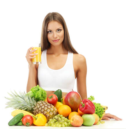 beautiful young woman with fruits and vegetables and glass of juice, isolated on white Stock Photo - 16346220