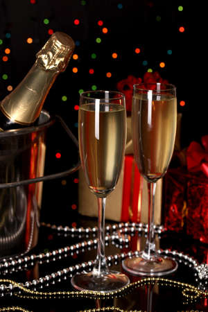 gold flute: Celebratory champagne with stemware on Christmas lights background