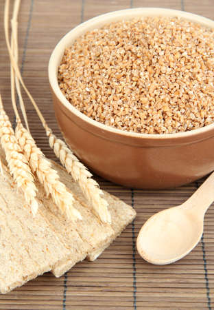 Brown bowl full of wheat bran Stock Photo - 16108006