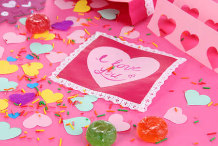 reciprocity: Beautiful composition of paper valentines and decorations on pink background close-up