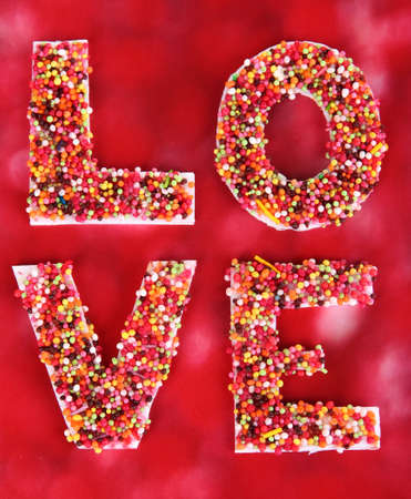 reciprocity: Word Love on red background