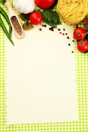 paper for recipes,vegetables and spices on green background