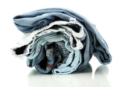 Lot of different blue jeans isolated on white photo