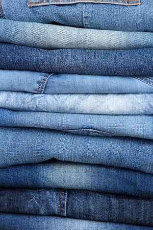 bluejeans: Many jeans stacked in a pile closeup