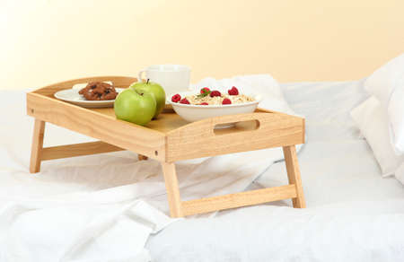 wooden tray with light breakfast on bed Stock Photo - 16132150