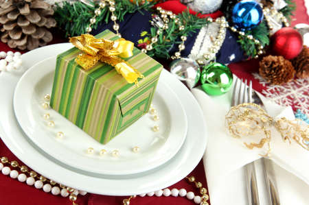 Small Christmas gift on plate on serving Christmas table background close-up Stock Photo - 16132403