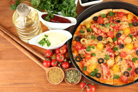 colorful composition of delicious pizza, vegetables and spices on wooden background close-up Stock Photo - 16132635