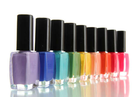 manicure nails: Group of bright nail polishes isolated on white