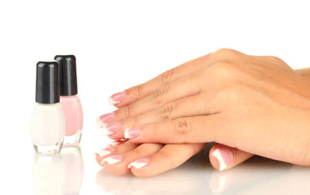 Beautiful woman's hands with jars of nail polish, on white background Stock Photo - 16131807