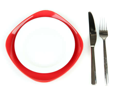 covered: Empty red and white plates with fork and knife isolated on white