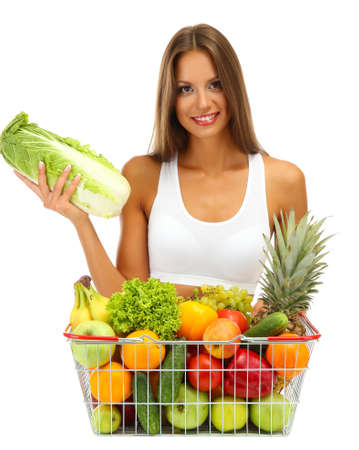 beautiful young woman with fruits and vegetables in shopping basket, isolated on white Stock Photo - 16346124