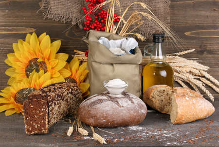 Different types of rye bread on wooden table on wooden background Stock Photo - 16132636