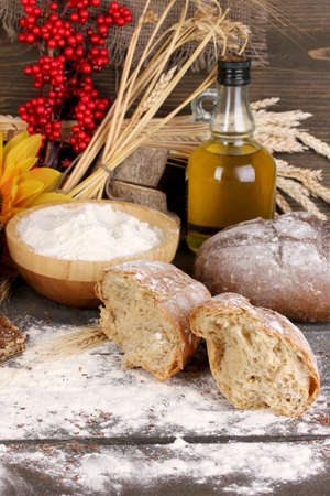Rye bread on wooden table on wooden background Stock Photo - 16132621