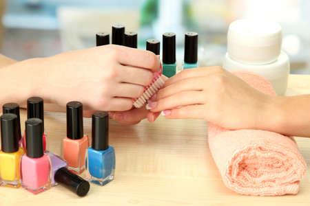 beauty treatment salon: Manicure process in beauty salon, close up