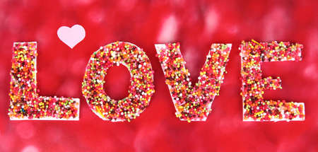 Word Love on red background photo