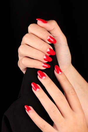 nail care: female hands on background color fabric