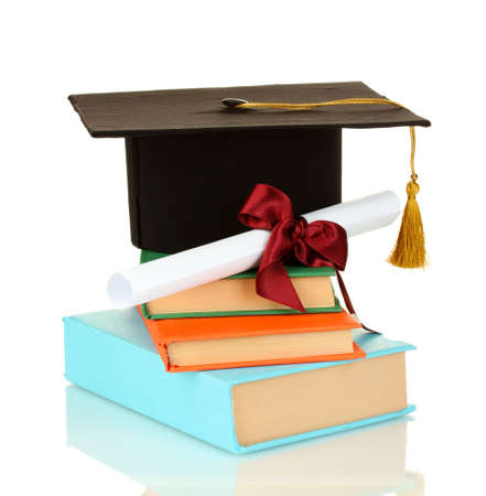Grad hat and diploma with books isolated on white photo