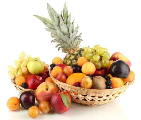 Still life of fruit in basket isolated on white photo