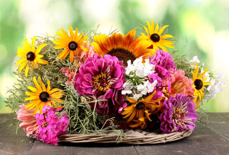 ronantic: Beautiful bouquet of bright flowers on  wooden table on nature background