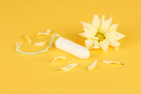 cotton tampon with yellow flower on orange background close-up Stock Photo - 16219660