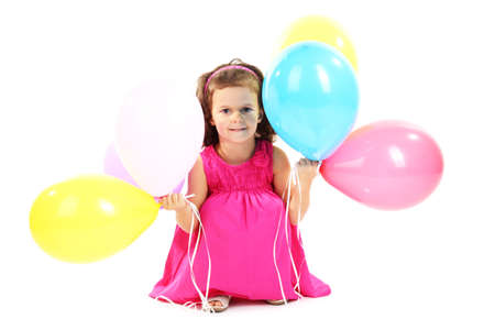 beautiful little girl with balloons isolated on white Stock Photo - 16547533