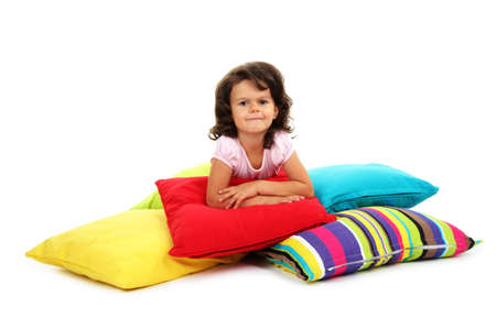 beautiful little girlwith pillows isolated on white Stock Photo - 16547529