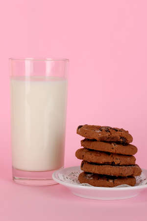 pasteurized: Glass of fresh new milk on pink background