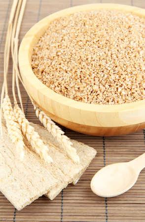 Wooden bowl full of wheat bran Stock Photo - 16220300